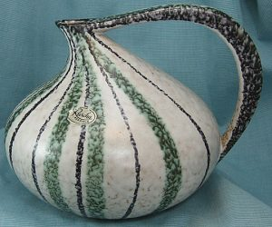 The original 313 form had lines that were perhaps a little too close to Murano glass in ways that molded pottery couldn't handle.